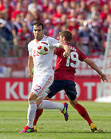 Spain forward Alvaro Negredo (22) attempts to control the ball as USA midfielder Robbie Rogers (19) defends. In a friendly match, Spain defeated USA, 4-0, at Gillette Stadium on June 4, 2011.