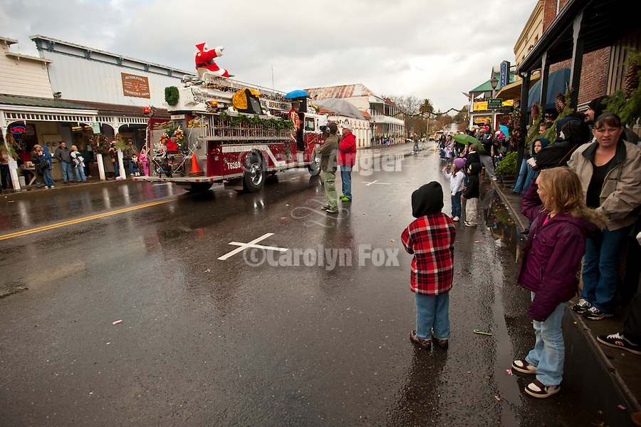 Ione Business and Community Association hosts the annual Main Street Christmas parade featuring Santa Claus riding a fire truck in the Mother Lode of Calif