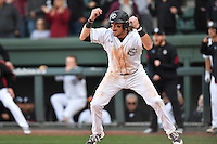 First baseman Matt Williams (48) of the South Carolina Gamecocks tells Jacob Olson to slide in the bottom of the ninth in the Reedy River Rivalry game against the Clemson Tigers on Saturday, March 4, 2017, at Fluor Field at the West End in Greenville, South Carolina. Clemson won, 8-7. (Tom Priddy/Four Seam Images)