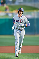 Austin Nola (14) of the Tacoma Rainiers runs off the field against the Salt Lake Bees at Smith's Ballpark on May 27, 2019 in Salt Lake City, Utah. The Bees defeated the Rainiers 5-0. (Stephen Smith/Four Seam Images)
