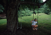 A young girl plays on a swing at the family homestead. The Caudill/Millers fought to save their home from a mountaintop removal mine.