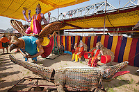 India. Uttar Pradesh state. Allahabad. Maha Kumbh Mela. International Society for Krishna Consciousness (ISKCON). Various figures from hinduism, such as Lord Vishnu (L) riding a Garuda, Brhaspati (old man seated with white beard), Indra (young man seated with mustache) and the crocodile as the Demon. Vishnu is a male Hindu God. He is also known as Narayana or Hari. Vishnu is seen as the Supreme God (including his different avataras), venerated as the Supreme Being. The Garuda is a large mythical bird or bird-like creature that appears in Hindu mythology. Brhaspati (lord of prayer or devotion, often written as Brihaspati or Bruhaspati) also known as Deva-guru (guru of the gods), is a Hindu god and a Vedic deity. He is considered the personification of piety and religion, and the chief 'offerer of prayers and sacrifices to the gods, with whom he intercedes on behalf of humankind. He is also known as Ganapati. Indra is the leader of the Devas or gods and Lord of Svargaloka or heaven in the Hindu religion. ISKCON is a religious movement that also identifies itself as The Hare Krishna Movement. ISKCON belongs to the Gaudiya-Vaishnava sampradaya, a monotheistic tradition within the Vedic and Hindu cultural traditions. It is based on the Bhagavad-gita, the spiritual teachings spoken by Lord Krishna who is revered as the Supreme Personality of Godhead. The Kumbh Mela, believed to be the largest religious gathering is held every 12 years on the banks of the 'Sangam'- the confluence of the holy rivers Ganga, Yamuna and the mythical Saraswati. The Maha (great) Kumbh Mela, which comes after 12 Purna Kumbh Mela, or 144 years, is always held at Allahabad. Uttar Pradesh (abbreviated U.P.) is a state located in northern India. 10.02.13 © 2013 Didier Ruef