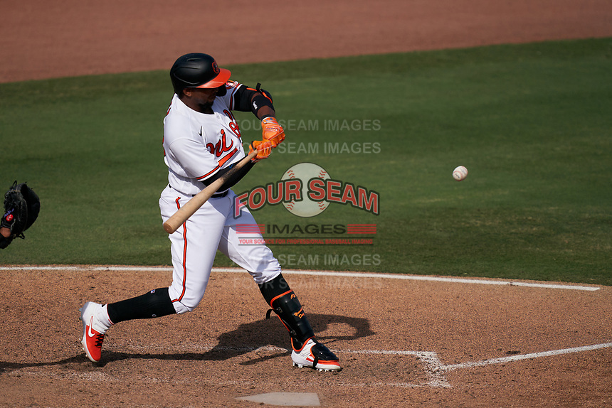 Baltimore Orioles Yusniel Diaz (23) bats during a Major League Spring Training game against the Philadelphia Phillies on March 12, 2021 at the Ed Smith Stadium in Sarasota, Florida.  (Mike Janes/Four Seam Images)
