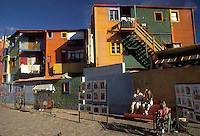AJ2029, market, Buenos Aires, Argentina, Tango, Local artist's in Caminito (little street) display their work at an artist market in the district of La Boca in the capital city of Buenos Aires. Laundry hanging from brightly painted timber and corrugated iron pop-art houses in the background.The Tango is supposed to have originated here.
