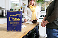 {November 7, 2009} 11:26:06 AM -- Fredericksburg, VA. -- Jody Williams, a Nobel Peace prize winner for her work in eradicating land mines, left, has pulled together a cookbook with recipes from other Nobel laureates and people who have worked for peace. She did the work in combination with her stepdaughter Emily Goose, right, as part of Emily's high school senior project.  ... -- ...Photo by Andrew B. Shurtleff, Freelance.