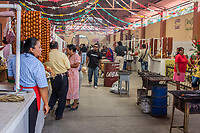Tlacolula, Oaxaca; Mexico.  Tlacolula's Covered Indoor Meat Market consists of many individual stalls.  In the middle of the corridor are small barbecue grills where buyers can cook their own purchase.