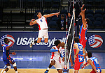 Dominican Republic's Figueroa Adames hits against Puerto Rico during the Pan American Cup at the Reno Events Center in Reno, Nev., on Monday, Aug. 17, 2015. <br /> Photo by Cathleen Allison