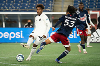 FOXBOROUGH, MA - OCTOBER 09: Rivaldo Ibarra #36 of Fort Lauderdale CF passes the ball as Hikaru Fujiwara comes in to tackle during a game between Fort Lauderdale CF and New England Revolution II at Gillette Stadium on October 09, 2020 in Foxborough, Massachusetts.