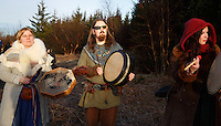 Members of the neo-pagan Asatru association beating drums and watching the solar eclipse in Reykjavik, Iceland.