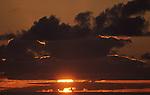 Sunrise off the coast of Terceria, Azores. (Jim Bryant Photo).....