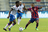KANSAS CITY, KS - JULY 11: Kellyn Acosta #23 of the United States defending against Carlens Arcus #2 of Haiti during a game between Haiti and USMNT at Children's Mercy Park on July 11, 2021 in Kansas City, Kansas.