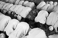 Mastariya, North Darfur, August 13, 2004.The village men during their Friday prayer; they are Arabs from the Rezeghat tribe, most of them are enlisted in Janjaweed militia after Musa Hillal, their Sheikh, gave full support to the Khartoum government allegedly to fight the SLA rebels.