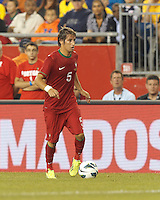 Portugal defender Fabio Coentrao (5) dribbles at midfield.  In an international friendly, Brazil (yellow/blue) defeated Portugal (red), 3-1, at Gillette Stadium on September 10, 2013.