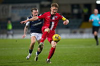 27th March 2021; Dens Park, Dundee, Scotland; Scottish Championship Football, Dundee FC versus Dunfermline; Euan Murray of Dunfermline Athletic controls the ball as Jason Cummings of Dundee tries to close him down