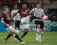 Calcio, Serie A: Milan vs Juventus. Milano, stadio San Siro, 9 aprile 2016. <br /> Juventus' Mario Mandzukic, right, is challenged by AC Milan's Alex, center, and Juraj Kucka, during the Italian Serie A football match between AC Milan and Juventus at Milan's San Siro stadium, 9 April 2016.<br /> UPDATE IMAGES PRESS/Isabella Bonotto