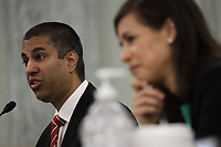 Ajit Pai, Chairman, Federal Communications Commission (FCC), left, testifies during a United States Senate Committee on Commerce, Science, and Transportation oversight hearing to examine the Federal Communications Commission in Washington, DC on June 24, 2020. Jessica Rosenworcel, Commissioner, Federal Communications Commission (FCC) listens at right.<br /> Credit: Alex Wong / Pool via CNP / Pool via CNP/AdMedia