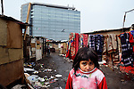 """THIS PHOTO IS AVAILABLE AS A PRINT OR FOR PERSONAL USE. CLICK ON """"ADD TO CART"""" TO SEE PRICING OPTIONS.   A girl in an illegal Roma settlement in Belgrade, Serbia. The families that live here, many of whom survive from recycling cardboard and other materials, are under constant threat of eviction in order to make way for new high-rise office buildings."""