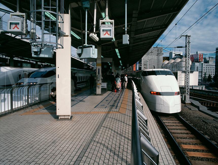 Modern bullet-trains standing in Tokyo station, Japa