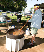 Chip Guillot, brother of trainer Eric Guillot, makes a big vat on gumbo on the backside.