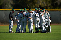 Dartmouth Big Green team meeting before a game against the Omaha Mavericks on February 23, 2020 at North Charlotte Regional Park in Port Charlotte, Florida.  Dartmouth defeated Omaha 8-1.  (Mike Janes/Four Seam Images)