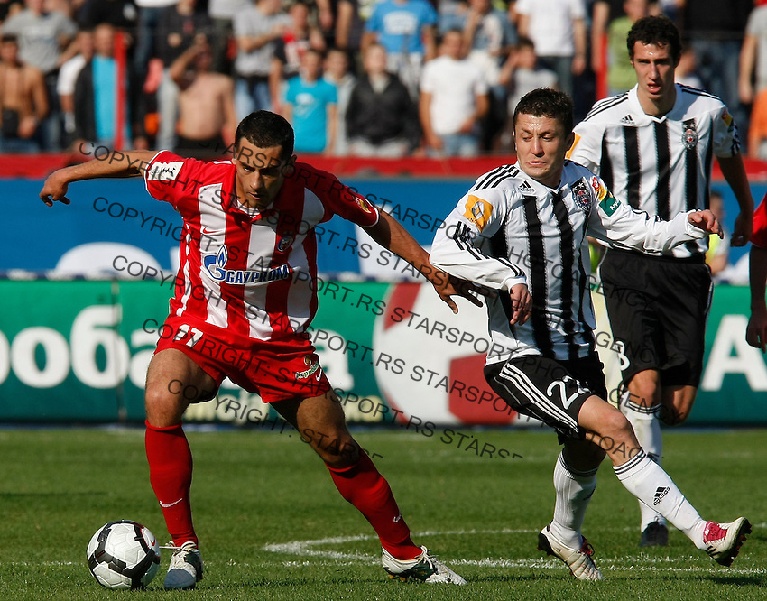 Milos Trifunovic, left in action against Sasa Ilic, right,  during the Serbian League soccer match in Belgrade, Serbia, Saturday, October  24, 2010. (Srdjan Stevanovic/Starsportphoto.com)