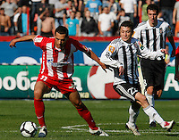Milos Trifunovic, left in action against Sasa Ilic, right,  during the Serbian League soccer match in Belgrade, Serbia, Saturday, October  24, 2010. (Srdjan Stevanovic/Starsportphoto.com)