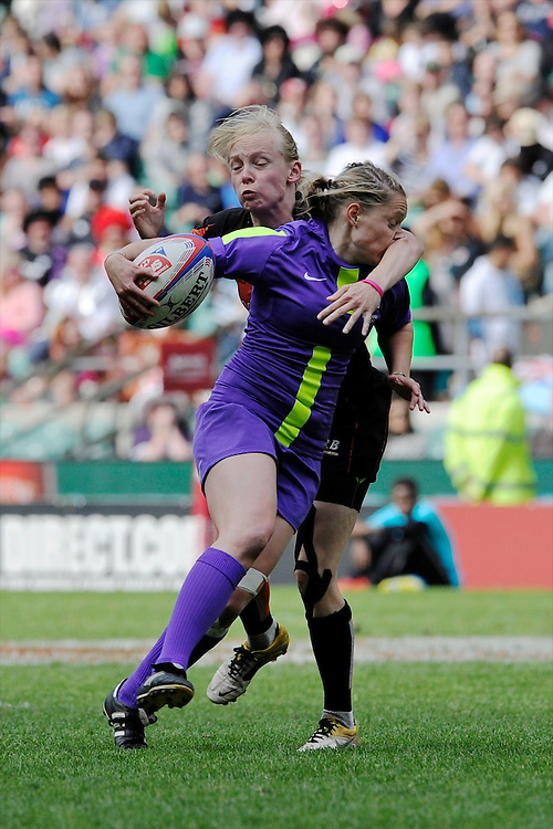 NatashaHunt of England is tackled during the iRB Marriott London Sevens at Twickenham on Sunday 13th May 2012 (Photo by Rob Munro)
