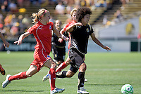 Becky Sauerbrunn (left) and Eriko Arakawa (right) chase down the ball. FC Gold Pride defeated Washington Freedom 3-2 at Buck Shaw Stadium in Santa Clara, California on August 1, 2009.