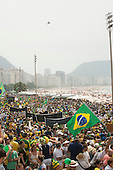 Protesters march on Copacabana Beach while a Military Police helicopter hovers overhead. Rio de Janeiro, Brazil, 15th March 2015. Popular demonstration against the President, Dilma Rousseff in Copacabana. Photo © Sue Cunningham sue@scphotographic.com.