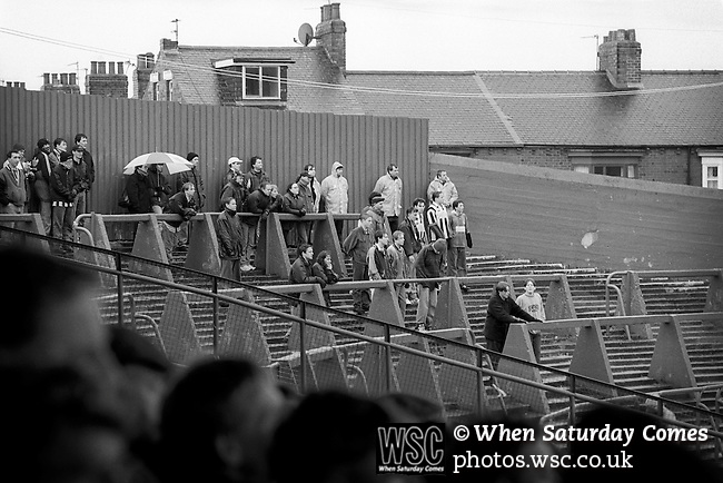 Grimsby fans in pouring rain at Ayresome Park. Middlesbrough 1 Grimsby Town 1, 21st January 1995. Photo by Paul Thompson