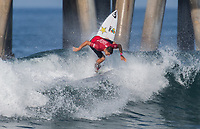 Huntington Beach, CA - Tuesday July 31, 2018: Ezekiel Lau in action during a World Surf League (WSL) Qualifying Series (QS) Men's round of 96 heat at the 2018 Vans U.S. Open of Surfing on South side of the Huntington Beach pier.