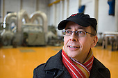 Jorma Peussa, Statistical Officer for the JHL public services union, in the turbine hall at Helsinki Energy, the municipally-owned company which supplies 90% of the Finnish capital's electricity.
