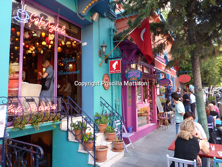 Istanbul, Turkey - September 25, 2009:  Colorful cafes with outdoor seating are busy.