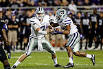 TCU Horned Frogs wide receiver Kolby Listenbee (7) hands off to Kansas State Wildcats running back John Hubert (33) in action during the game between the Kansas State Wildcats and the TCU Horned Frogs  at the Amon G. Carter Stadium in Fort Worth, Texas. Kansas State defeats TCU 23 to 10...