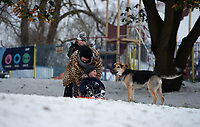 Mum gives her son a push while sledging in the park in Sidcup as the dog looks on following Heavy Snowfall at Sidcup, Kent, England on the 8 February 2021. Photo by Alan Stanford.