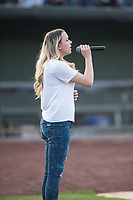 A young singer performs the National Anthem before a Pioneer League game between the Great Falls Voyagers and Idaho Falls Chukars at Melaleuca Field on August 18, 2018 in Idaho Falls, Idaho. The Idaho Falls Chukars defeated the Great Falls Voyagers by a score of 6-5. (Zachary Lucy/Four Seam Images)