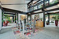 BNPS.co.uk (01202) 558833. <br /> Pic: Savills/BNPS<br /> <br /> Pictured: Dining area. <br /> <br /> The UK home of Hollywood actor Antonio Banderas is on the market for £2.95m.<br /> <br /> The Mask of Zorro star moved from LA to Cobham in Surrey in 2015 with girlfriend Nicole Kimpel after splitting from his wife of 20 years Melanie Griffiths.<br /> <br /> They are now selling their home to spend more time in Banderas' native Malaga, where he has bought and built a theatre.