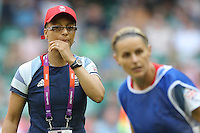 Great Britain Coach Hope POWELL watches the players warm up - Great Britain Women vs New Zealand Women - Womens Olympic Football Tournament London 2012 Group E at the Millenium Stadium, Cardiff, Wales - 25/07/12 - MANDATORY CREDIT: Gavin Ellis/SHEKICKS/TGSPHOTO - Self billing applies where appropriate - 0845 094 6026 - contact@tgsphoto.co.uk - NO UNPAID USE.