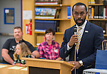 Dr. Carlos Phillips II comments during a presentation of a prosthetic arm created with a 3D printer to 6-year-old Gracie at Washington High School, November 2, 2015.