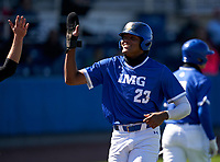 IMG Academy Ascenders James Wood (23) high fives teammates after scoring a run during a game against the Lakeland Dreadnaughts on February 20, 2021 at IMG Academy in Bradenton, Florida.  (Mike Janes/Four Seam Images)