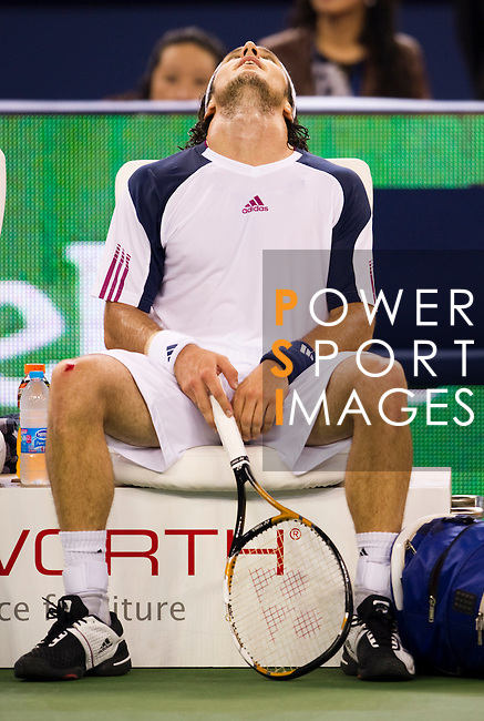 SHANGHAI, CHINA - OCTOBER 16:  Juan Monaco of Argentina reacts on the bench during his match against Andy Murray of Great Britain during day six of the 2010 Shanghai Rolex Masters at the Shanghai Qi Zhong Tennis Center on October 16, 2010 in Shanghai, China.  (Photo by Victor Fraile/The Power of Sport Images) *** Local Caption *** Juan Monaco