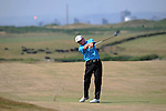 Chris Williams of England on the 13th hole during The Senior Open Golf Tournament at The Royal Porthcawl Golf Club in South Wales this afternoon, with the Port Talbot steelworks in the background.