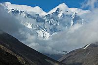 Through the clouds Everest, Lhotse, Nuptse, Khumbu, Nepal