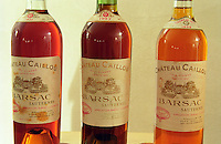 Three bottles of Chateau Caillou of varying age (1921, 1937, 1959) showing the change in colour that occurs when sauternes wine ages.  Chateau Caillou, Grand Cru Classe, Barsac, Sauternes, Bordeaux, Aquitaine, Gironde, France, Europe