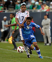 Cuba's Marcel Hernandez pressures El Salvador's Reynaldo Hernandez.  El Salvador defeated Cuba 6-1 at the 2011 CONCACAF Gold Cup at Soldier Field in Chicago, IL on June 12, 2011.