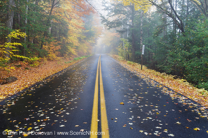 Tripoli Road in Woodstock, New Hampshire USA on a foggy and rainy autumn morning. Parts of this road follow the old railroad bed of the Woodstock & Thornton Gore Railroad (1909-1914).