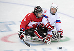 Sochi, RUSSIA - Mar 15 2014 - Anthony Gale as Canada takes on Norway in the Bronze Medal Sledge Hockey game  at the 2014 Paralympic Winter Games in Sochi, Russia.  (Photo: Matthew Murnaghan/Canadian Paralympic Committee)
