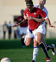 Ferreiras, PORTUGAL: Natasha Kai is stoped by Finland player at the Nora Stadium in Ferreiras, March 09 of 2007, during the Algarve Women´s Cup soccer match between USA and Finland. USA won 1-0. Paulo Cordeiro/International Sports Image