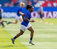 PARIS,  - JUNE 16: Crystal Dunn #19 warms up during a game between Chile and USWNT at Parc des Princes on June 16, 2019 in Paris, France.