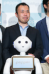 Kenichi Yoshida, vice president of business development for SoftBank Robotics and robot Pepper pose for the cameras at Pepper for Biz 2.0 on July 20, 2016, Tokyo, Japan. Yoshida along with other guests spoke about the new features of Pepper such as Chinese response and speech recognition, and duty free tax refunds and electronic payments services, in response to business needs. The presentation was held a day before the start of Pepper World 2016 exhibition, where developers will introduce applications for SoftBank's robot Pepper. Pepper World will run until July 22. (Photo by Rodrigo Reyes Marin/AFLO)